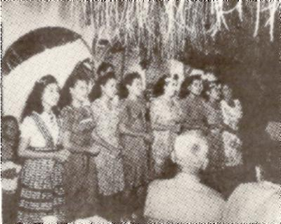 "These ""Rotary Annes."" Daughter of Guam Rotary Club members. serenade guests at t banquet at which the Guam Rotary Club was re-created after having been temporarily wiped out during the Japanese occupation on the American Possession"