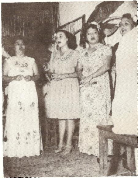 A quarter composed of (1to r.) Mrs. B.J. Bordallo(wife of the president of the Guam Rotary Club, Miss Nancy Underwood, Mrs. Rosalie Langford and Miss Rose Underwood, serenade guests at a banquet held to celebrate the official re-opening of the Guam Rotary Club recently.