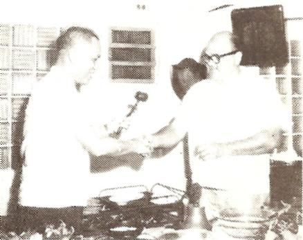 Installation of Ray Underwood as President of Rotary Club of Guam at Surf Club in Asan, 1956. Presenting the gavel is Judge of the Island Court, Rotarian Vicente C. Reyes.