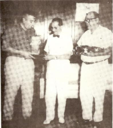 Sec. Charlie Christopher and PP Ray Underwood making Joseph Flores an honorary member on the occasion of his being appointed as Governor of Guam in 1960.