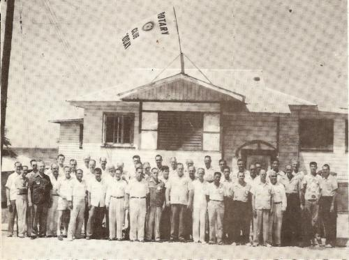 Members of Rotary Club of Guam in front of Surf Club in Asan. l to r: Joseph Flores, Cliff Marks, Ray Underwood, Gene Krapft, Jojo Salas, Gonzales Eclavea, Bartolome Umayam, B.P. Carbullido, Alex Andrews, Ken Jones, Terrence Morgan, Jesus Rivera, Doc Crain, Ross Fulford, Pedro Martinez, James Butler, James Steward, unidentified, Lyle Turner, Carl Lamont, Jack Cole, Guy Wharton, unidentified, Russell Stevens, Bill Sinclair, Hal Odell, John Haitma, unidentified, Joe Owens, Dick Suydam, Hank Meyer, George Bourland, Gerorge Selwyn, unidentified, Tomas Santos, Norm Flockman, A.T. Bordallo, Vicente Reyes, Jose Perez, Jessee Cook, Dick Klepper, Irby Barker, Hank Weinhold.