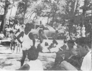 Jack (ET) Calvo in white sport shirt in left background.