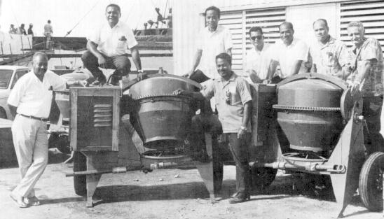 In connection with these Project Asiste, the Saipan Rotary Club ordered and recently received two cement mixers to start on their project of building cement houses to the people needing the most help in building. Rotarians above are (left to right) Chairman Glenn Brown, Elias Okamura, Joe Tenorio and George Perdew. The mixers will be used in pouring foundations and making blocks.